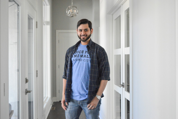 "Model stands handsomely in a delightful blue tee shirt with the words ""Voice For Animals Kansas City"" printed on it"